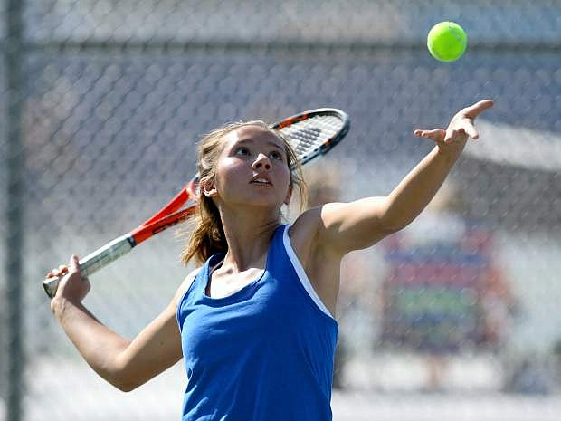 Singles player Anya Woodbury serves in a match against Douglas on Tuesday.