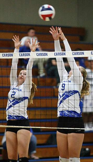 Natalie Anderson (2) and Maddie Jergensen (9) go up for a block on Thursday night in a game against Hug. The Senator girls won in three games.