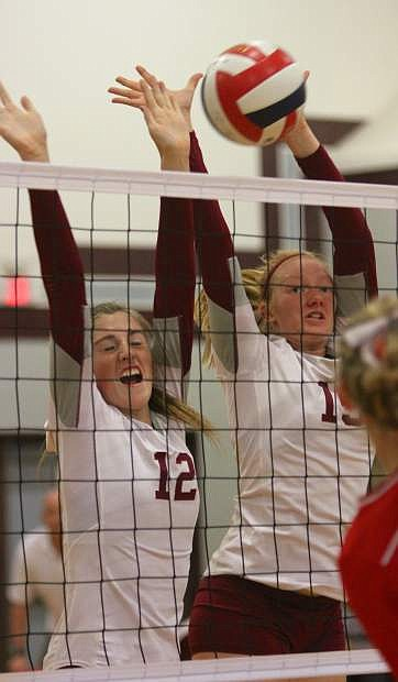 Kallie Strong and Kaylee Turner go up for a block against the Pershing County Mustangs Wednesday at Dayton High.
