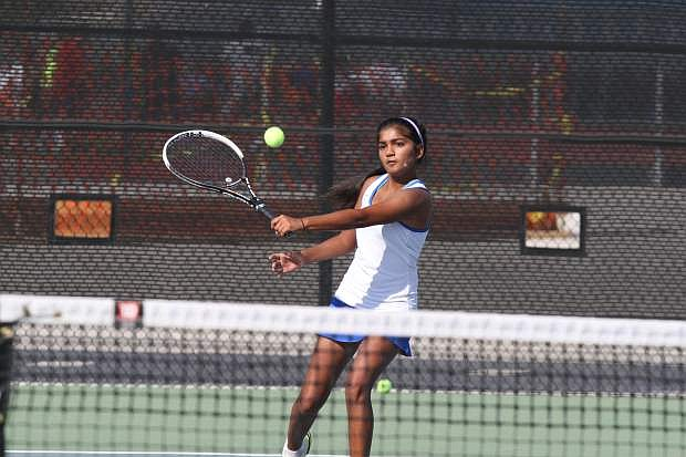 Singles player Preeta Amin returns a volley in her match against North Valleys on Tuesday.