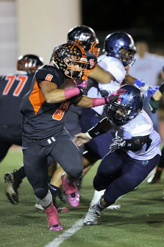 Ryland DeSomber runs with the football for Douglas against Damonte Ranch on Friday.