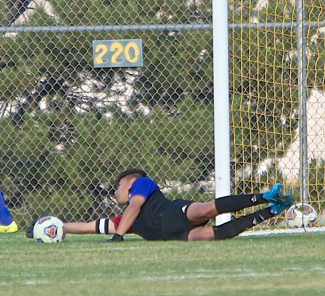 Carson goalie Efren Ramirez stretches to block a Galena shot Wednesday afternoon in Reno.