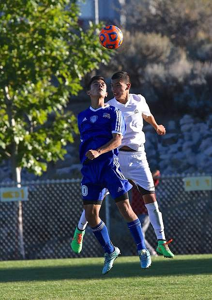 Guillermo Galvan-Hernandez battles for the ball with a Galena player Wednesday in a game that ended in a 1-1 tie at Galena High.