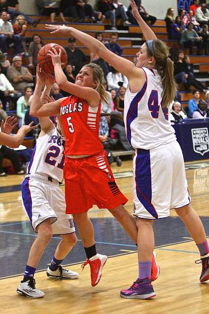 Reno's Mallory McGwire (44) and the Reno Huskies were too much for Alyssa Holley (5) and the the Douglas Tigers Friday night in the North NIAA semifinals at Morse Burley Gymnasium. The Huskies defeated the Tigers 61-28 and advance to the finals against Manogue.