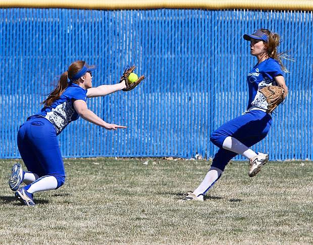 Senator left-fielder Brittany Bailey catches a Reed flyball Saturday at CHS.