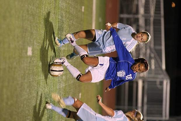 Mayra Olivares passes to a teammate in a game against Reed on Tuesday.