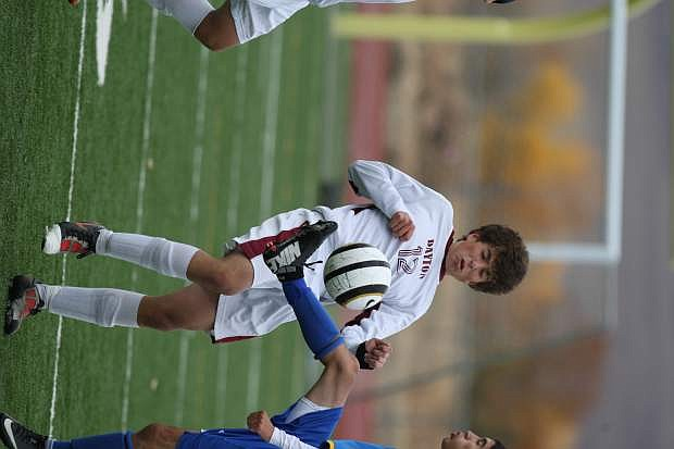 Spencer Ruiz avoids a collision with a South Tahoe player in their match on Tuesday.
