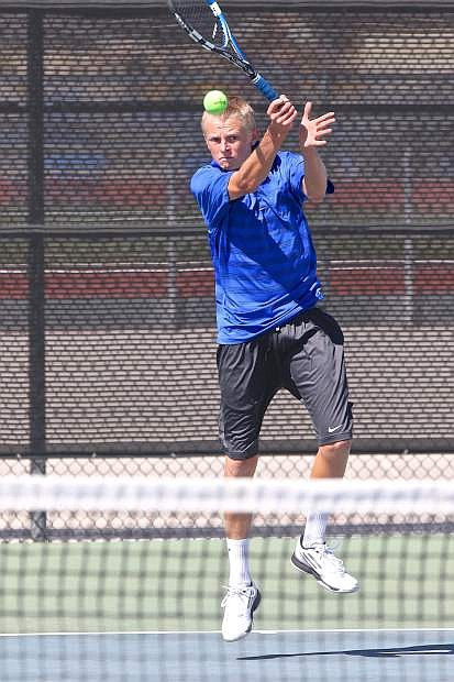 Junior Taylor Saarem, Carson High Tennis Team's no.1 seed, volleys with his Spanish Springs opponent Thursday afternoon at CHS.