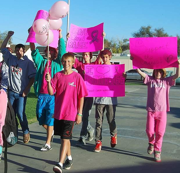 """Churchill county middle and high school students protest Friday morning outside of the middle school to try and persuade school officials to let students wear breast cancer awareness  """"I love boobies"""" barcelets."""