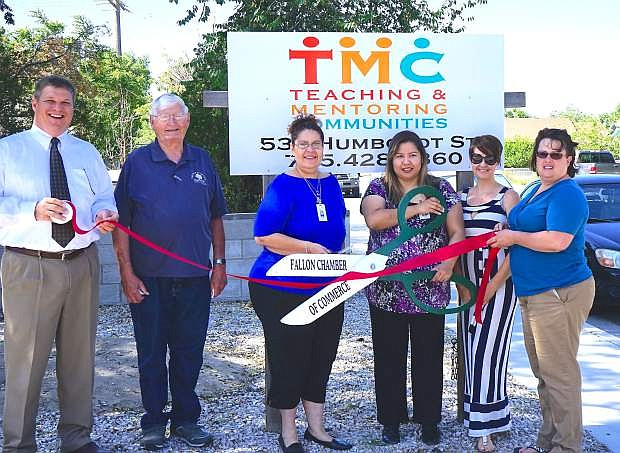 A ribbon cutting for TMC was recently held. From left are  Doug Drost, Chamber of Commerce vice president; John Tewell;      Mirta Horn, Natalie Parrish, Chamber of Commerce executive director; and Kim Klenakis, CEDA.