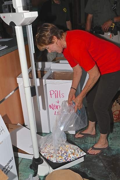 Kathy Bartosz, Exec. Director of Partnership Carson City weighs a 6 1/2 pound bag of unused or expired prescription pills collected at the CCSO's drop box in the front lobby. In all, 199 lbs. of pills and 49 needles were collected Saturday. Unopened non-prescription medications were also collected and donated to FISH.
