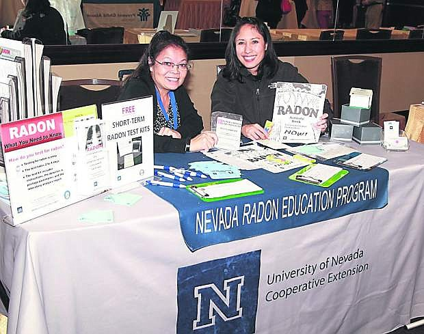 Susan Howe, radon program director, and Jamie Roice-Gomes, radon education coordinator with University of Nevada Cooperative Extension, provide free radon test kits at health fairs.