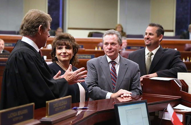 Ron Parraguirre. left, Chief Justice of the Nevada Supreme Court congratulates new state assembly members Stephanie Smith, Kyle James Stephens and Dominic Brunetti after swearing them in on Monday.