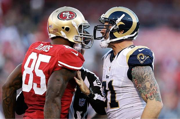 San Francisco 49ers tight end Vernon Davis (85) faces off with St. Louis Rams defensive end Chris Long during the fourth quarter of an NFL football game in San Francisco, Sunday, Dec. 1, 2013. (AP Photo/Marcio Jose Sanchez)