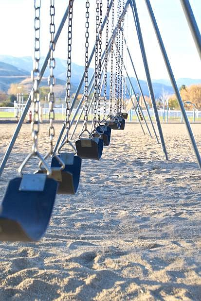A vacant swingset is seen here at Seeliger Elementary School Friday afternoon. Carson City parents want more recess time for their children.