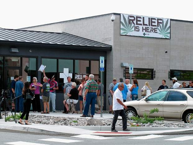 Dozens of people lined up outside the Silver State Relief medical marijuana dispensary in Sparks, Nevada last year. A ballot question on legalization is now meeting with opposition from big names in Nevada politics.