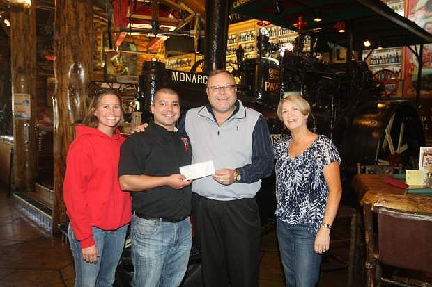 "Participating in the ""It Just Takes One"" campaign, Red's Old 395 Grill general manager Sam Rojas, left, presents a check for more than $1,000 to Cliff Sorensen, secretary for the Boys & Girls Club of Wester Nevada on Tuesday. Looking on are Jessica Wright, left, marketing coordinator for Reds and Susie Messina, special events coordinator for the Boys & Girls Club. "" I would like to thank all our patrons who donated to a great cause."" said Rojas."