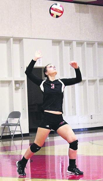 Simpson University defensive specialist Kelsey Reibsamen goes up for the serve during a match in the fall.