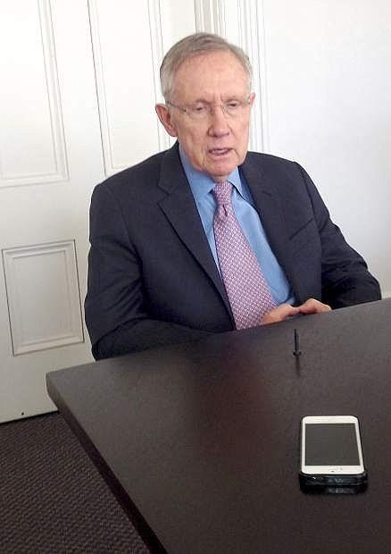 Sen. Harry Reid, D-Nev., talks to reporters in Carson City in 2014.