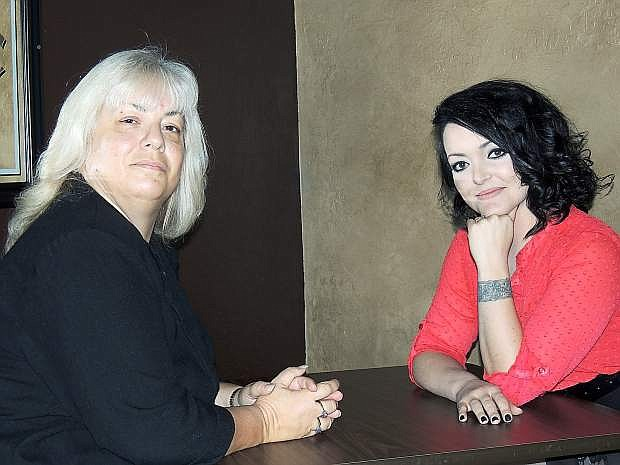 Lisa Tucker and Megan Torres, co-owners of Remedy's Bar in Carson City, take a break from a meeting at their business.