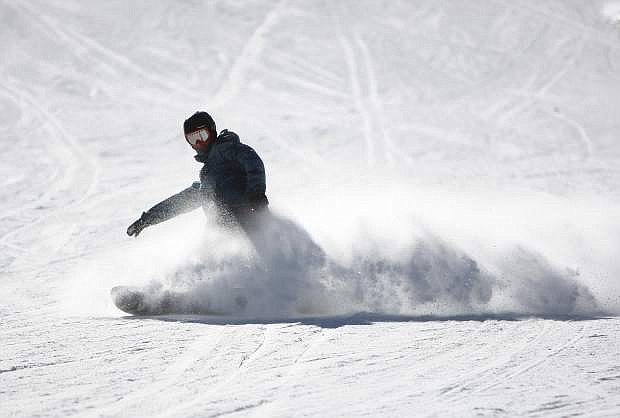 A snowboarder on Friday rides down to Stagecoach Express, a chairlift at Heavenly Mountain Resort that opened Wednesday.