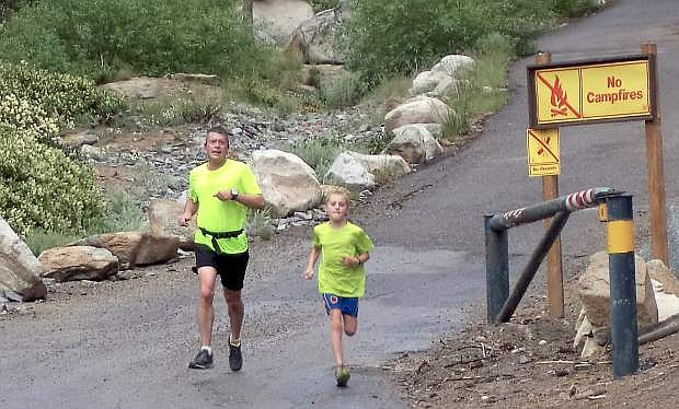 Bryce Lehmann, right, and his father, Sean, head to the finish line Saturday at the 41st annual Ponderosa Ridge Ridge. Bryce, 10, a Fritsch Elementary School student, became the youngest finisher in the 9.5-mile trail run from Spooner Summit to Kingsbury (his brother Parker, 11, was the previous record holder in 2014).