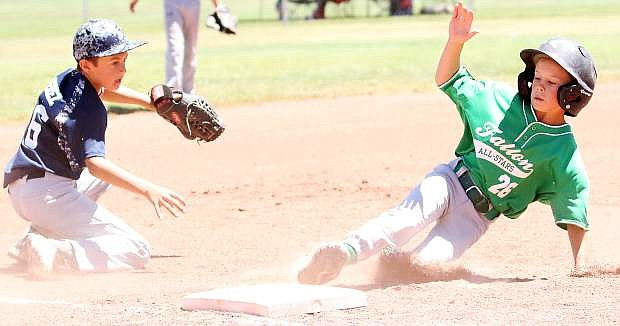 Fallon's Evan Giovanetti, right, slides in successfully at third against Silver State in the 9-under all-star tournament Saturday.