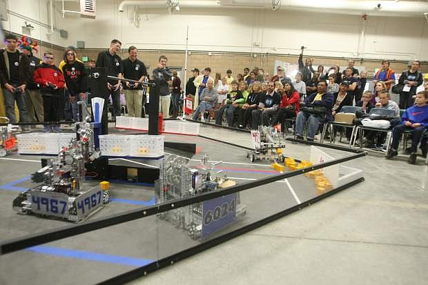 Teams compete in the First Tech Challenge at Western Nevada College on Saturday. The game, FTC Block Party, requires two teams to work as an alliance to place blocks in the pendelum goal baskets while keeping them balanced and blocking the other teams progress. Points are scored when various goals are achieved.