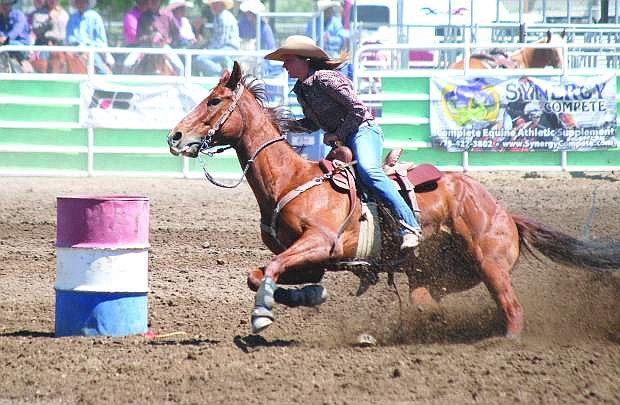 Fallon's Rachel Hendrix rides around an obstacle during the barrel racing competition at the Nevada High School State Rodeo at the Churchill County Fairgrounds in June.