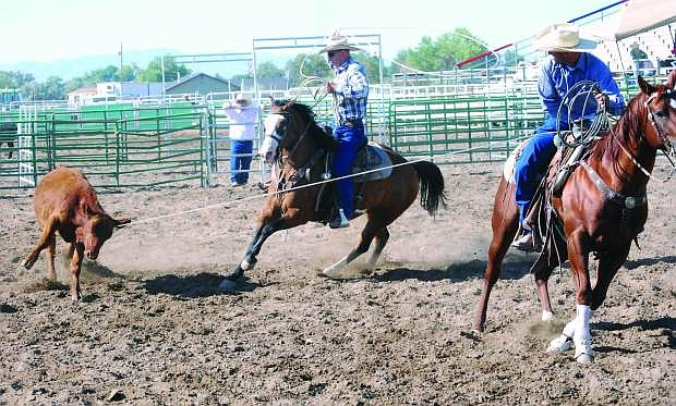 Flint and Jimmy Lee of Lee Stockhorses team rope a calf to be branded in a previous year's Fallon Ranch Rodeo.