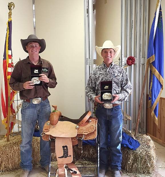 Jake Cerini, left, and Blain Jensen pose for a photo after taking the state title in team roping.