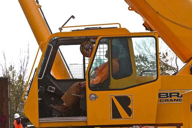 Kevin Porter of Sparks operates the crane at Great Basin Imaging on Saturday.