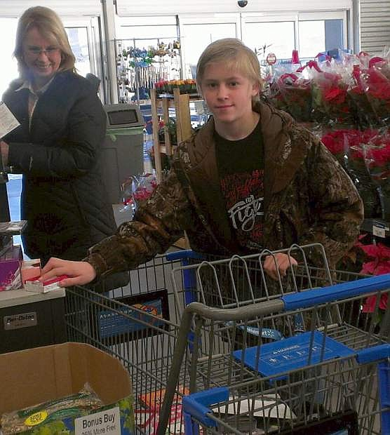 Rotarian Genevieve Fredrick shops with Kenny Brus.