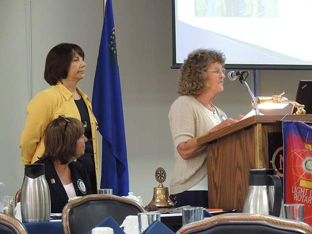 Karen Allen speaks while Angela Barosso (standing) and Anne Hansen, Rotary president, listen Tuesday.