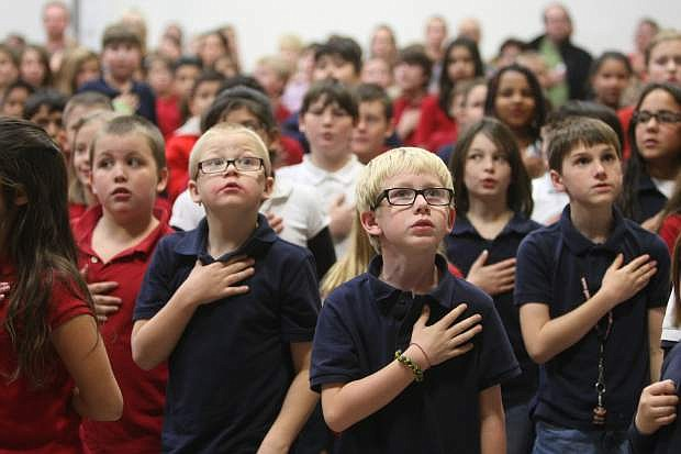 Seeliger Elementary School students sing the National Anthem on Friday afternoon during their Veterans Day celebration.