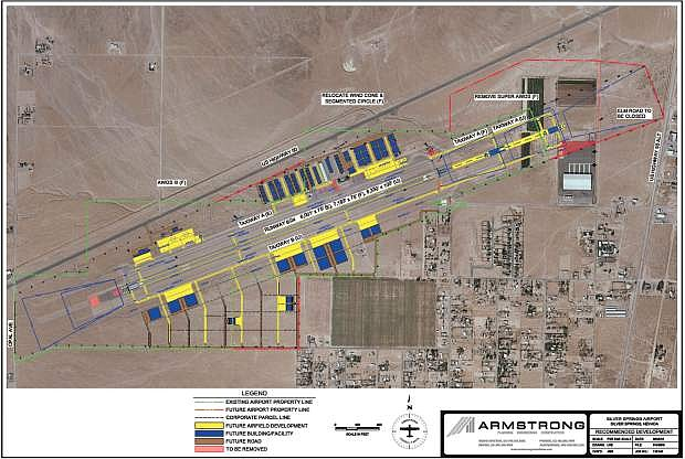 The Silver Springs Airport is seen in this aerial photograph overlaid with future development proposed in an updated master plan. Airfield development is seen in yellow and buildings and facilities, in blue.