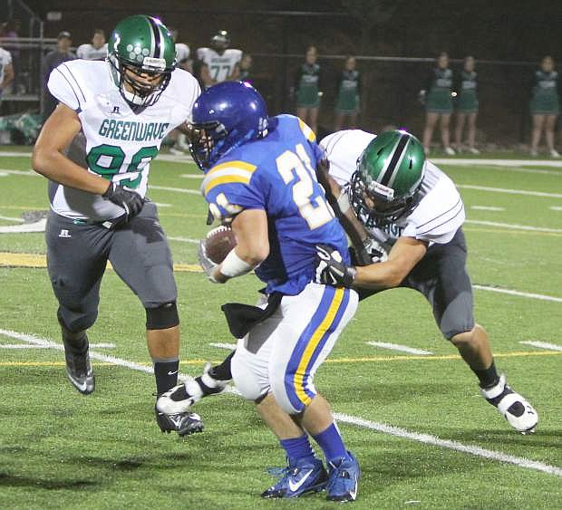 Fallon defensive lineman Hunter Holcomb, right, and T.J. Magua bring down South Tahoe running back Dylan Gardner during the Wave's 48-21 win on Friday.