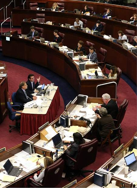 Nevada Gov. Brian Sandoval's Chief of Staff Mike Willden, center left, and Economist Jeremy Aguero testify in an Assembly Committee of the Whole hearing at the Legislative Building on Saturday.
