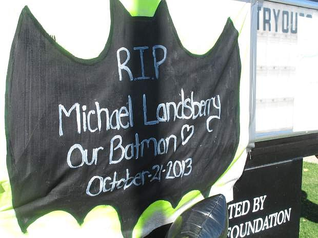 Michael Landsberry's reputation as a big fan of Batman figures prominently in the makeshift memorial in front of Sparks Middle School Wednesday, Oct. 23, 2013, in Sparks, Nev.   Landsberry  was killed and two students wounded at teh school before a 12-year-old gunman turned a handgun on himself on Oct. 21, 2013. (AP Photo/Scott Sonner).