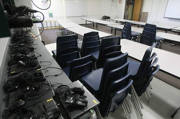 Laptops for a new computer lab at Mark Twain Elementary School are organized in a classroom on Wednesday.
