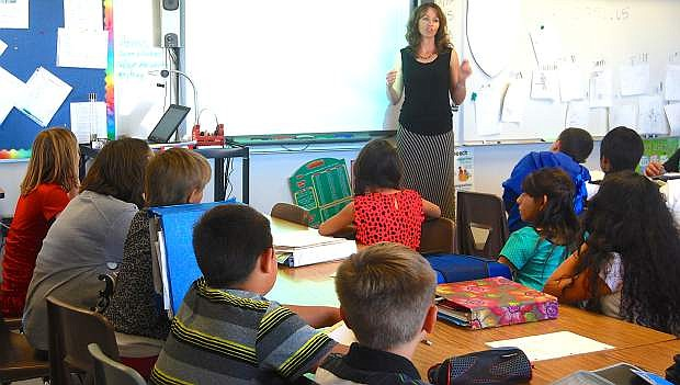 Numa Elementary School's fifth grade teacher Lisa Solinski instructs her students during class.