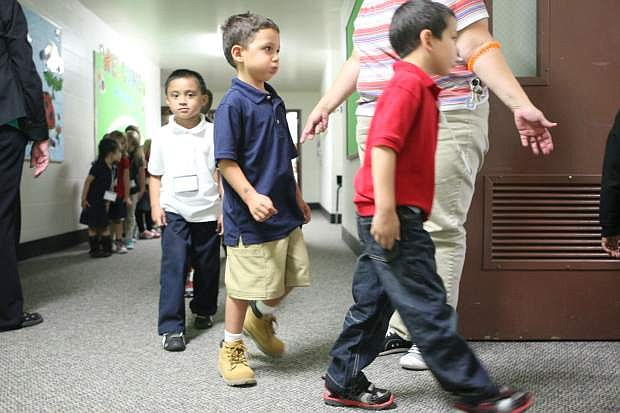 Seeliger Elementary School kindergarteners in Lorena Reimann's class practice walking into class silently on Wednesday afternoon.