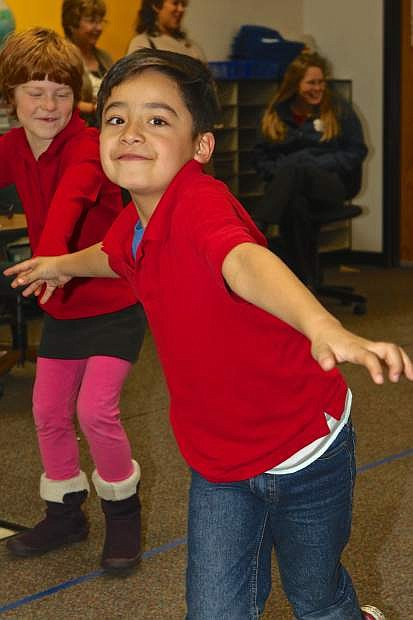 1st grader Angel Montes freezes in place during a warm-up for the Science Theater Thursday at Fremont Elementary.