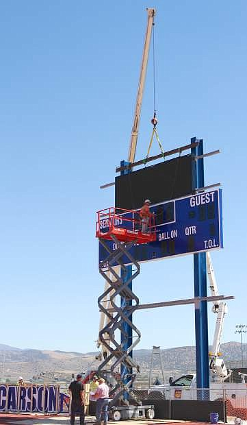 A new scoreboard is going up on the south end of the football field at Carson High on Wednesday.