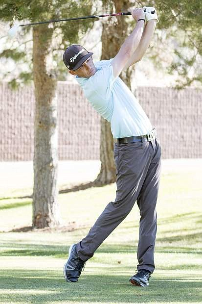 Scott Smith tees off during a practice round.