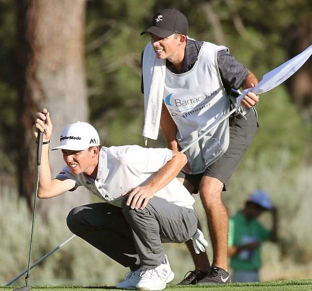 Scott Smith, left, and brother/caddy Shane, survey the green before lining up to putt in Friday's round at the Barracuda Championships in Reno.