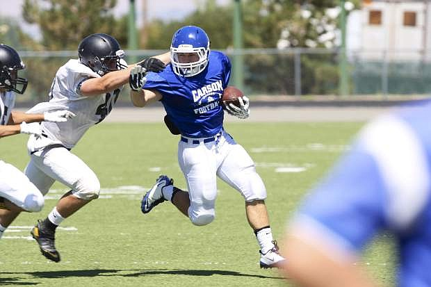 Carson running back Colby Brown makes a nice gain in a scrimmage against Galena on Saturday at Manogue High School.
