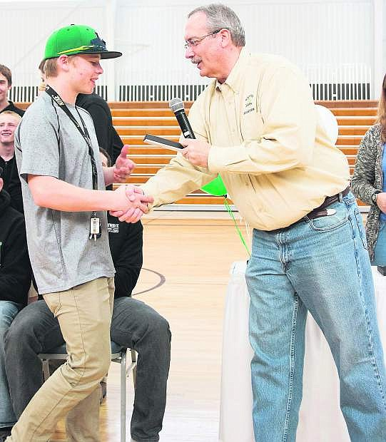 Fallon's Sean McCormick, left, shakes hands with Mayor Ken Tedford in March when the city honored the Wave state champion wrestling team.