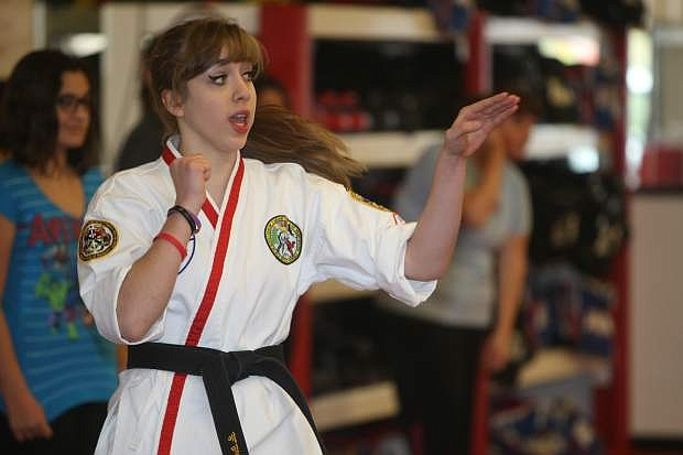 Seventeen-year-old Emily Eiswert explains a self defense move on Saturday morning at Carson ATA Martial Arts. Eiswert hosted a women's self defense class as part of her Carson High School senior project. She also collected paper goods for Advocates to End Domestic Violence.
