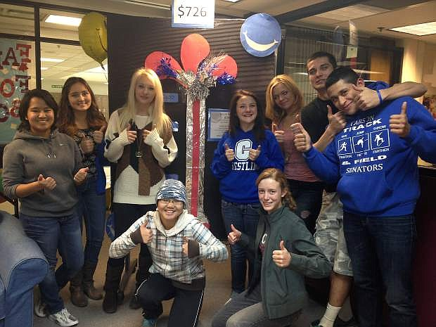 Carson High School students received $729 for the library from Carson City Orthodontics.